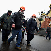 KIEV, UKRAINE - February 20, 2014: Anti-government protestors carry the body of a dead man, killed during violente clashes with the riot police outside Independence Square in central Kiev. The riot police responded to the advance with gunfire that, according to the opposition, killed at least 70 and as many as 100 people. The drastic escalation of the three-month-old Ukraine crisis left the country reeling from the most lethal violence in decades. CREDIT: Paulo Nunes dos Santos