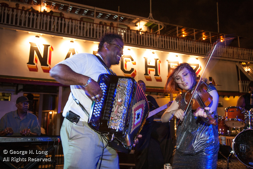 Amanda Shaw performs with Rockin' Dopsie at French Quarter Festival party on the Riverboat Natchez
