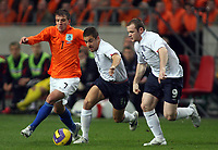 Photo: Paul Thomas.<br /> Holland v England. International Friendly. 15/11/2006.<br /> <br /> Rafael van der Vaart (L) takes on England pair Joe Cole (C) and Wayne Rooney.