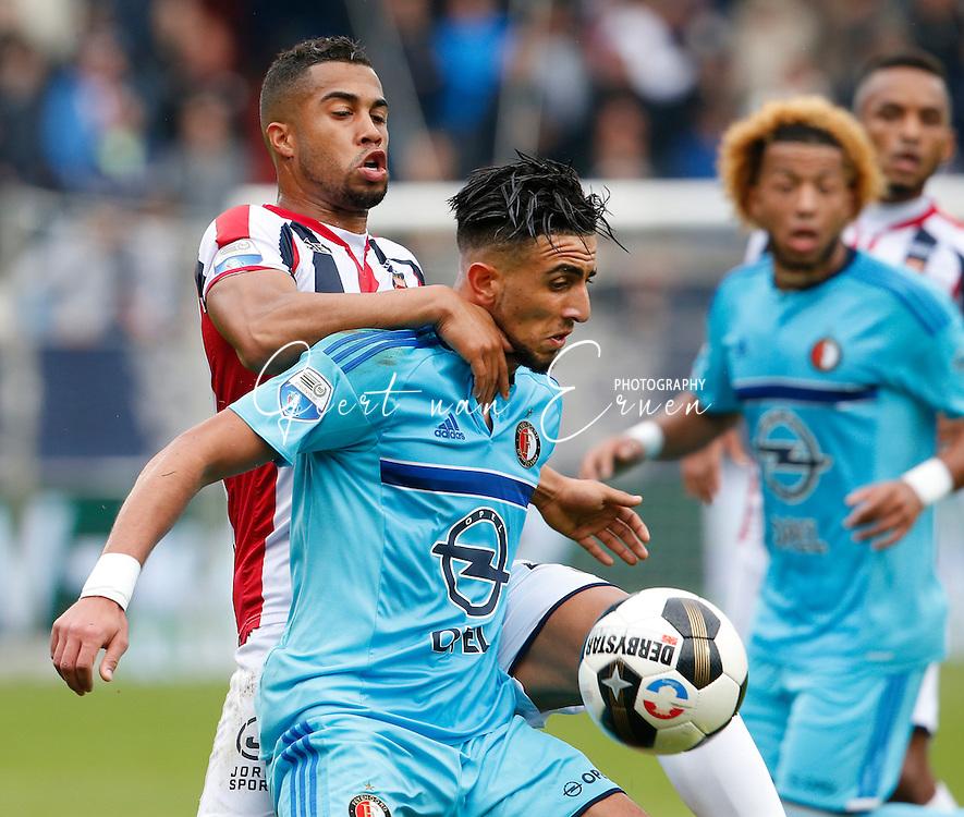 02-10-2016 VOETBAL:WILLEM II - FEYENOORD:TILBURG<br /> Bilal Basacikoglu van Feyenoord in duel met Pele van Anholt van Willem II <br /> <br /> <br /> Foto: Geert van Erven