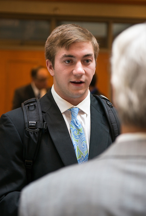College of Business student, Tucker Skove, speaks with a professor before the Walter Center for Strategic Leadership Speaker Series in the Baker Center Theater, on September 10, 2013.