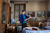 VERBANIA, ITALY - 18 APRIL 2017: Rosemarie Santoni, the wife of one of Emma Morano's nephews who assisted her, gathers some personal belonging of Emma Morano in her small room in Verbania, Italy, on April 18th 2017.<br /> <br /> Emma Morano, born in 1899, was an Italian supercentenarian who, prior to her death at the age of 117 years and 137 days, was the world's oldest living person whose age had been verified, and the last living person to have been verified as being born in the 1800s. She died on April 15th 2017.