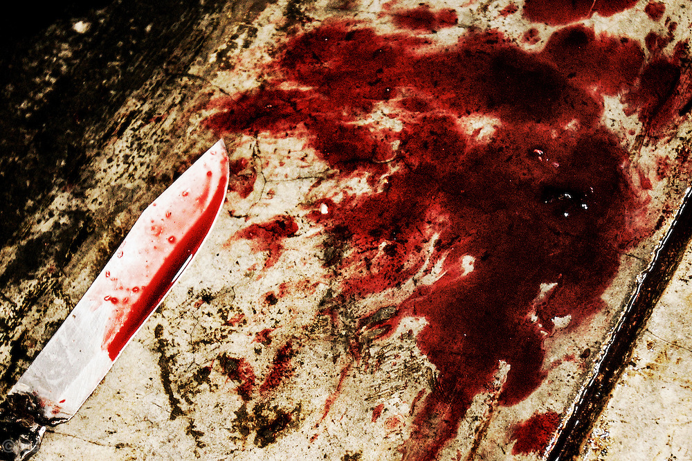 A KNIFE AND BLOOD ON THE FLOOR OF THE SLAUGHTERHOUSE