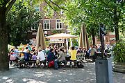 Het terras bij het Ledig Erf in Utrecht. Na dagen van regen, geniet Nederland weer van het mooie weer. De terrassen in Utrecht zijn goed gevuld.<br /> <br /> The cafe Ledig Erf in Utrecht.