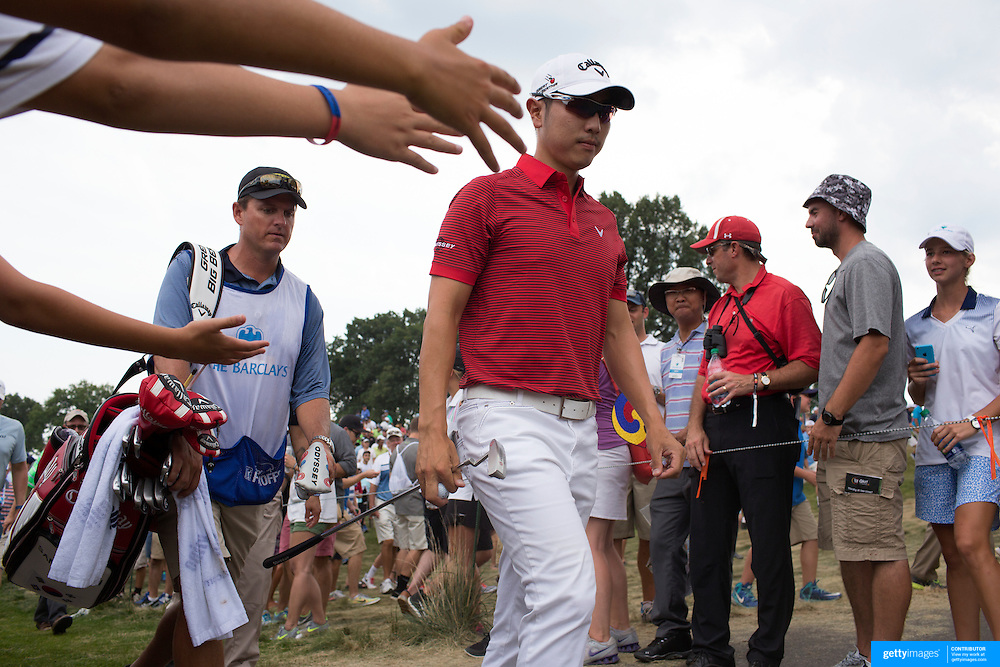 Sangmoon Bae, South Korea, receives attention from fans as he walks to the seventeenth tee during the final round of The Barclays Golf Tournament at The Plainfield Country Club, Edison, New Jersey, USA. 30th August 2015. Photo Tim Clayton