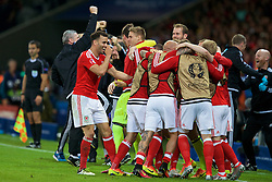 LILLE, FRANCE - Friday, July 1, 2016: Wales substitutes celebrate the third goal to make the score 3-1 during the UEFA Euro 2016 Championship Quarter-Final match against Belgium at the Stade Pierre Mauroy. Hal Robson-Kanu, David Edwards, goalkeeper Owain Fon Williams. (Pic by Paul Greenwood/Propaganda)