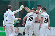Wicket - Josh Davey of Somerset celebrates taking the wicket of Ollie Pope of Surrey with Jamie Overton of Somerset who took the catch during the opening day of the Specsavers County Champ Div 1 match between Somerset County Cricket Club and Surrey County Cricket Club at the Cooper Associates County Ground, Taunton, United Kingdom on 18 September 2018.
