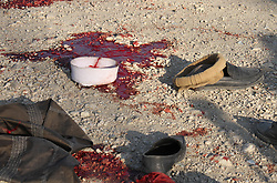 January 1, 2018 - Jalalabad, Afghanistan - Blood hats and shoes at the scene of a bomb blast that targeted the funeral of a former district governor on the outskirts of Jalalabad, Afghanistan, on December 31, 2017. Local officials said 15 killed and 15 others injured. (Credit Image: © Wali Sabawoon/NurPhoto via ZUMA Press)