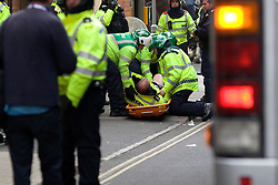 © Under license to London news Pictures. 09/10/2010. A Police officer is injured and taken away. The English Defence League (EDL) protest on streets of Leicester