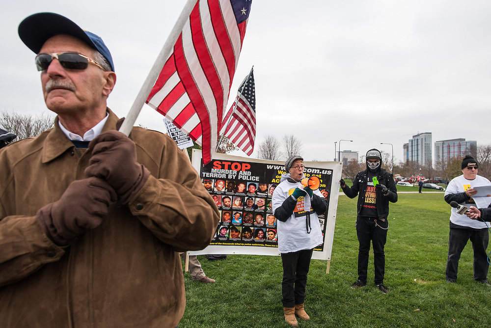 Former Chicago Police Officer Joe Garofalo, left, stands in protest of members of the Revolution Newspaper who support Colin Kaepernick of the San Francisco 49ers and his decision to kneel during the national anthem.