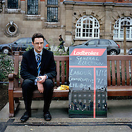 UK. London. The Village Green: From Blair to Brexit.<br /> A story on the relationship between the Media, Politicians and the public as they come together on College Green, a small patch of land next to The Houses of Parliament in Westminster. <br /> Photo shows a man from the betting company Ladbrokes showing the odds on the outcome of the 2005 General Election.<br /> Photo&copy;Steve Forrest/Workers' Photos