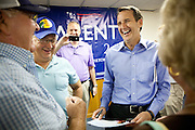 Former Minnesota Gov. Tim Pawlenty talks with Iowans at a campaign stop at Briggs Wood Golf Course in Webster City, Iowa, July 21, 2011.