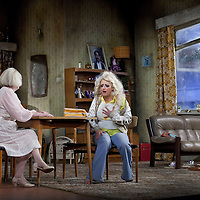 Louise McCarthy  and Barbara Rafferty <br /> <br /> Yer Granny - a new production by The National Theatre of Scotland opens at the Beacon arts Centre, Greenock, Scotland.<br /> <br /> <br /> Based on La Nona by Roberto Cossa<br /> In a new version by Douglas Maxwell<br /> Directed by Graham McLaren<br /> <br /> <br /> Picture by Drew Farrell<br /> Tel : 07721-735041<br /> Image offered on a speculative basis.<br /> <br /> Yer Granny is a riotous new comedy about a diabolical 100-year-old granny who&rsquo;s literally eating her family out of house and home. She&rsquo;s already eaten their fish and chip shop into bankruptcy and now she&rsquo;s working her way through their kitchen cupboards, pushing the Russo family to desperate measures just to survive beyond 1977.<br /> <br /> As proud head of the family, Cammy is determined that The Minerva Fish Bar will rise again and that family honour will be restored &ndash; and all in time for the Queen&rsquo;s upcoming Jubilee visit. But before Cammy&rsquo;s dream can come true and before Her Maj can pop in for a chat, a single sausage and a royal seal of approval, the family members must ask themselves how far they will go to solve a problem like Yer Granny.<br /> <br /> Adapted from the smash-hit Argentinian comedy classic La Nona, the cast of Yer Granny features some of Scotland&rsquo;s best-loved performers, including Gregor Fisher in the title role, alongside Paul Riley (Still Game), Jonathan Watson (Only An Excuse?), Maureen Beattie (Casualty), Barbara Rafferty (Rab C Nesbitt), Brian Pettifer (The Musketeers) and Louise McCarthy (Mamma Mia!, West End).<br /> <br /> Performance dates :<br /> The Beacon Arts Centre, Greenock<br /> 19/05/2015&nbsp;-&nbsp;21/05/2015 <br /> <br /> King's Theatre, Glasgow<br /> 26/05/2015&nbsp;-&nbsp;30/05/2015 <br /> <br /> King's Theatre, Edinburgh<br /> 02/06/2015&nbsp;-&nbsp;06/06/2015 <br /> <br /> Eden Court, Inverness<br /> <br /> Lyric Theatre, Belfast<br /> 23/06/2015&nbsp;-&nbsp;27/