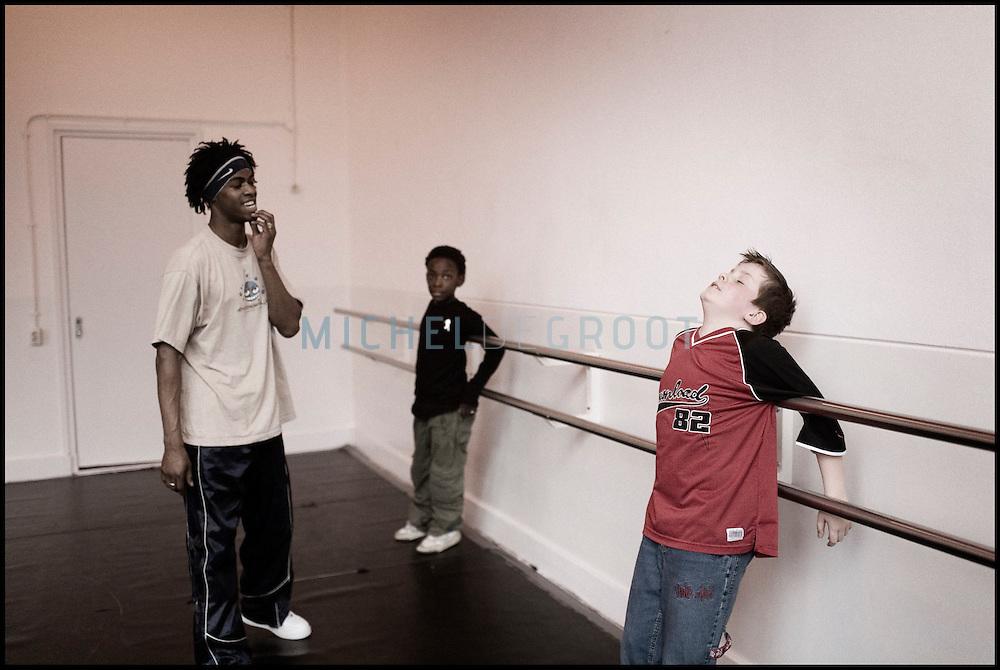 Professional dancer Edsel Cameron teaches young students at the HipHop2 (quadrate) School in Arnhem in the Netherlands. At the Hip Hop school youngsters from 10 to 25 can take workshops in rap, hip hop, breakdance and DJ Spinning...In Arnhem is sinds januari 2006 een HipHopschool gevestigd. Op deze school kunnen jongeren van tussen de 10 en 25 jaar workshops volgen in Rap, R&B zang, Breakdance, HipHop dance en DJ Spinning. Dit iniatief is tot stand gekomen door een samenwerking van Stichting Interart en de Arnhemse Rapgroep ' Andere Gekte'.  Arnhem, NETHERLANDS - 15-2-06: