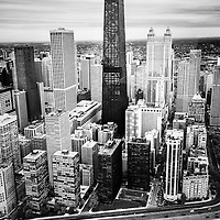 Chicago aerial picture in black and white with John Hancock Building and Lake Shore Drive on an overcast cloudy day. Aerial photo is high resolution and was taken in 2013.