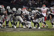 Oakland Raiders quarterback Derek Carr (4) takes a knee in the victory formation as the Raiders win their first game of the season during the NFL week 12 regular season football game against the Kansas City Chiefs on Thursday, Nov. 20, 2014 in Oakland, Calif. The Raiders won their first game of the season 24-20. ©Paul Anthony Spinelli