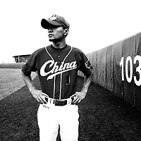 BEIJING, JULY -18: Sun Linfeng, member of the national baseball team, poses in the field .
