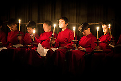© Licensed to London News Pictures. 27/11/2016. York UK. Choir boys wait to take part in the candle light Advent procession took place at York Minster last night (Sunday 27th) the Minster Advent procession start's in darkness, gradually light spreads through the Cathedral as candle light is passed from one person to the next. The candle light event is a service of Advent music, readings & prayers in celebration of God's promise of Jesus Christ , the light of the world. Photo credit: Andrew McCaren/LNP