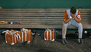 Center fielder Joe Ferin holds his head in his hands after the Longhorns' 5-4 loss to the Rice Owls on Wednesday evening at the College World Series in Omaha, NE.  Texas' season was ended by the loss...Alex Jones