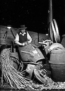 16/12/1959<br /> 12/16/1959<br /> 16 December 1959<br /> <br /> Dick Doherty a Copper at Powers Distillery in Dublin prepares a Cask for the Whiskey. Mr. Doherty can trace his family tradition as coppers back from father to son for 300 years.