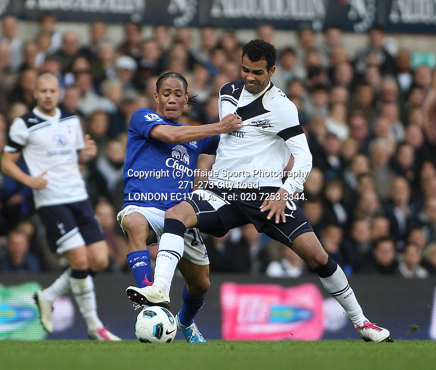 23/10/2010 Premier League football. Tottenham Hotspur v Everton.<br /> Francois Pienaar grabs the shirt of Tottenham substitute Sandro.<br /> Photo: Mark Leech.