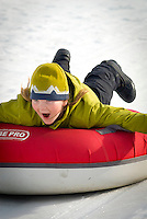 A boy goes snow tubing at Snow King Mountain in Jackson, Wyoming.