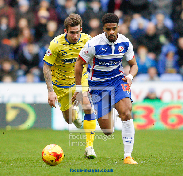Garath McCleary of Reading (R) goes past Joe Mattock of Sheffield Wednesday (L) during the Sky Bet Championship match at the Madejski Stadium, Reading<br /> Picture by Andrew Tobin/Focus Images Ltd +44 7710 761829<br /> 31/01/2015