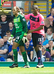 BLACKBURN, ENGLAND - Saturday, August 14, 2010: Everton's Sylvain Distin consoles goalkeeper Tim Howard who looks dejected after his mistake gifted Blackburn Rovers the opening goal during the Premiership match at Ewood Park. (Pic by: David Rawcliffe/Propaganda)