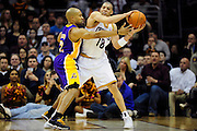 Feb. 16, 2011; Cleveland, OH, USA; Cleveland Cavaliers shooting guard Anthony Parker (18) looks for a pass around Los Angeles Lakers point guard Derek Fisher (2) during the fourth quarter at Quicken Loans Arena. The Cavaliers beat the Lakers 104-99. Mandatory Credit: Jason Miller-US PRESSWIRE