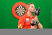 Dimitri Van den Bergh with his winners trophy during the PDC Unicorn World Youth Championship Final at Butlins Minehead, Minehead, United Kingdom on 26 November 2017. Photo by Shane Healey.