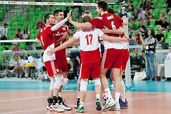 Players of team Poland celebrate point during volleyball match between National teams of Slovenia and Poland in 4th Qualification game of CEV European Championship 2015 on May 23, 2014 in Arena Stozice, Ljubljana, Slovenia. Photo by Urban Urbanc / Sportida