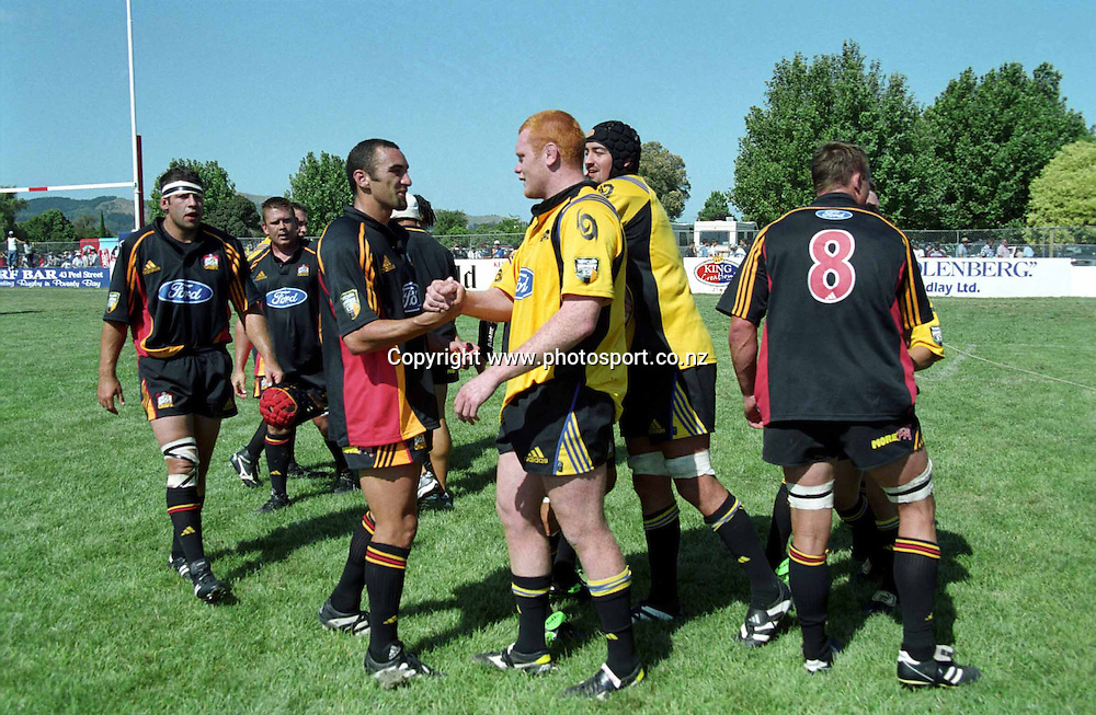 Roger Randle and Paul Tito shake hands after the rugby union Super 12 pre-season match between Hurricanes and the Chiefs, 3 February, 2001. Photo: PHOTOSPORT *** Local Caption ***