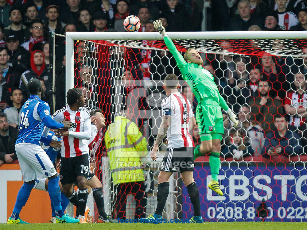 Daniel Bentley of Brentford tips the ball onto the bar during the FA Cup 3rd round match between  Brentford and Eastleigh FC  at Griffin Park, London<br /> Picture by Mark D Fuller/Focus Images Ltd +44 7774 216216<br /> 07/01/2017