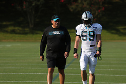 July 28, 2018 - Spartanburg, SC, U.S. - SPARTANBURG, SC - JULY 28: Head Coach Ron Rivera Carolina Panthers and Luke Kuechly (59) linebacker Carolina Panthers walk together to the practice field for the third day of the Carolina Panthers training camp practice at Wofford College July 28, 2018 in Spartanburg, S.C. (Photo by John Byrum/Icon Sportswire) (Credit Image: © John Byrum/Icon SMI via ZUMA Press)