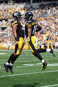 Pittsburgh Steelers rookie running back James Conner (30) and Pittsburgh Steelers rookie wide receiver JuJu Smith-Schuster (19) leap ini the air and do a hip bump as they celebrate after JuJu scores a second quarter touchdown good for a 14-0 Steelers lead during the 2017 NFL week 2 regular season football game against the against the Minnesota Vikings, Sunday, Sept. 17, 2017 in Pittsburgh. The Steelers won the game 26-9. (©Paul Anthony Spinelli)