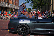 Aug 3, 2019; Canton, OH, USA; Ty Law (left) with daughter Sydney Law (center) and presenter Byron Washington during the Pro Football Hall of Fame Grand Parade on Cleveland Ave. in Downtown Canton. (Robin Alam/Image of Sport)