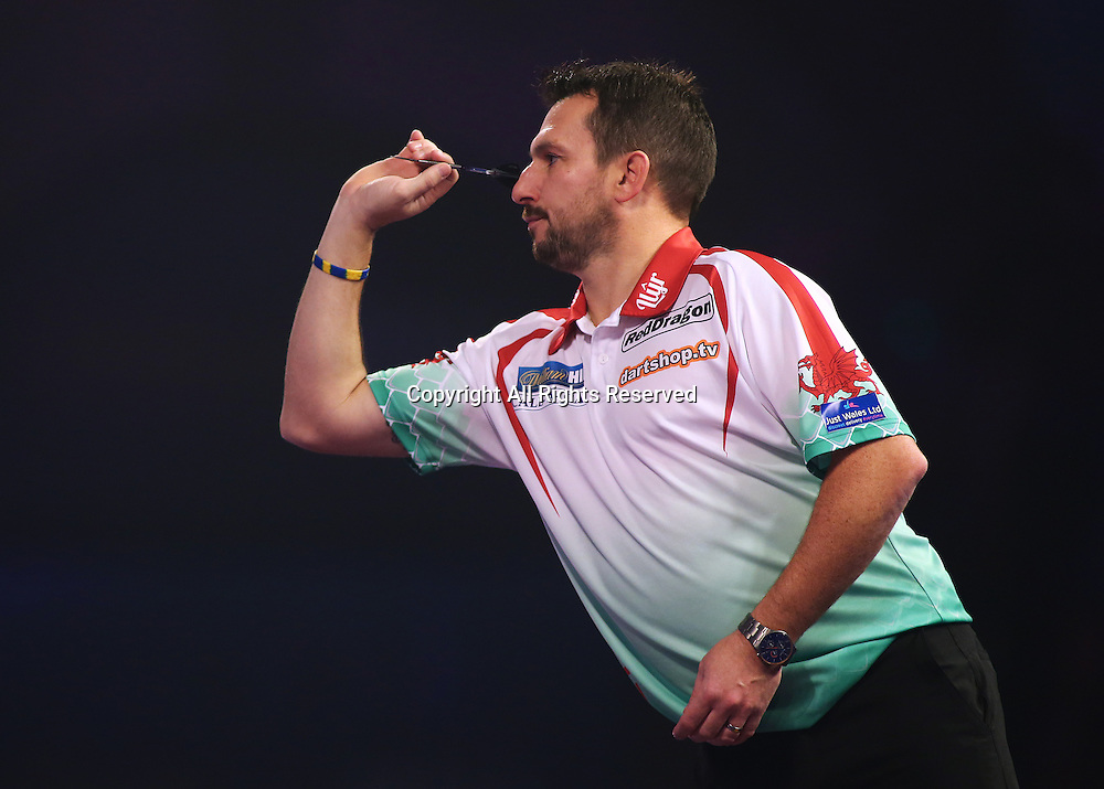 23.12.2016. Alexandra Palace, London, England. William Hill PDC World Darts Championship. Jonny Clayton throws during the first leg of his match with Ian White