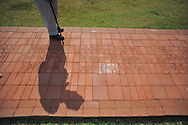 Army veteran James Cooke looks over bricks etched with the names of veterans at the dedication of the new Veterans Park in Oxford, Miss. on Saturday, June 30, 2012.