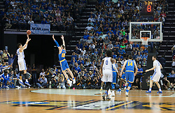 Kentucky forward Derek Willis hits a three point basket in the second half. <br /> <br /> The University of tKentucky hosted the University of California Los Angeles in a 2017 NCAA Division 1 Sweet 16 game, Friday, March 24, 2017 at FedExForum in Memphis.