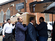Ali Jafari's funeral prayers  <br /> Mr Ali Jafari, aged 82,  died following the fire at Grenfell Tower,<br /> 14th July 2017 <br /> Outside the Hussaini Islamic Mission, Thornbury Road, Isleworth, <br /> <br /> Mr Jafari's three sons and family carry the coffin to the hearse <br /> <br /> Bashir Jafari <br /> <br /> Hamid Jafari <br /> <br /> Farid Jafari <br /> <br /> <br /> Photograph by Elliott Franks <br /> Image licensed to Elliott Franks Photography Services