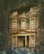 Petra, Jordan, rock-hewn capital of the Nabataens, c100 BC, 'A rose-red city half as old as Time'.  The facade of the treasury. Early 20th century photograph. Archaeology