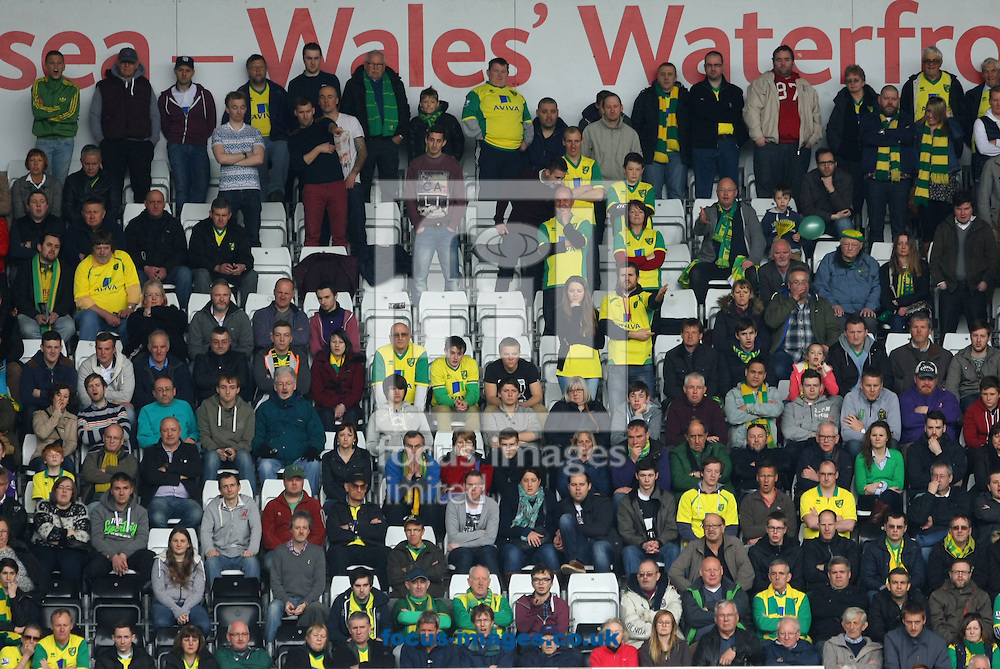 The traveling Norwich fans during the Barclays Premier League match at the Liberty Stadium, Swansea<br /> Picture by Paul Chesterton/Focus Images Ltd +44 7904 640267<br /> 29/03/2014