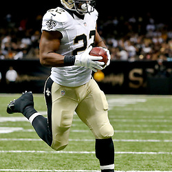 Aug 16, 2013; New Orleans, LA, USA; New Orleans Saints running back Mark Ingram (22) against the Oakland Raiders during the first quarter of a preseason game at the Mercedes-Benz Superdome. Mandatory Credit: Derick E. Hingle-USA TODAY Sports
