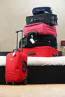 Stack of suitcases on bed