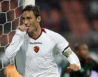 """Francesco Totti (Roma) sucks his thumb celebrating second goal for AS Roma<br /> <br /> Francesco Totti festeggia il secondo gol della Roma succhiandosi il pollice<br /> <br /> Italian """"Serie A"""" 2006-07 <br /> <br /> 11 November 2006 (Match Day 11) <br /> <br /> Milan Roma (1-2) <br /> <br /> """"Giuseppe Meazza"""" Stadium-Milano-Italy <br /> <br /> Photographer Andrea Staccioli INSIDE"""