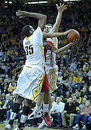 January 26, 2012: Nebraska Cornhuskers guard Toney McCray (0) puts up a shot between Iowa Hawkeyes forward Devon Archie (35) and Iowa Hawkeyes forward Zach McCabe (15) during the NCAA basketball game between the Nebraska Cornhuskers and the Iowa Hawkeyes at Carver-Hawkeye Arena in Iowa City, Iowa on Thursday, January 26, 2012.