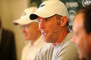 Brett Favre, winks to the media during a press conference with New York Jets owner Woody Johnson and general manager Mike Tannenbaum during a press conferece August 7, 2008 at Cleveland Browns Stadium