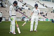 Sam Robson and Nick Gubbins of Middlesex take to the pitch to start the Specsavers County Champ Div 1 match between Hampshire County Cricket Club and Middlesex County Cricket Club at the Ageas Bowl, Southampton, United Kingdom on 14 April 2017. Photo by David Vokes.