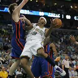 New Orleans Hornets forward Morris Peterson #9 is fouled in mid-air by David Lee #42 of the New York Knicks in the third quarter of their NBA game on April 4, 2008 at the New Orleans Arena in New Orleans, Louisiana. New Orleans Hornets defeated the New York Knicks 118-110 and with the win clinched a NBA Playoff birth.