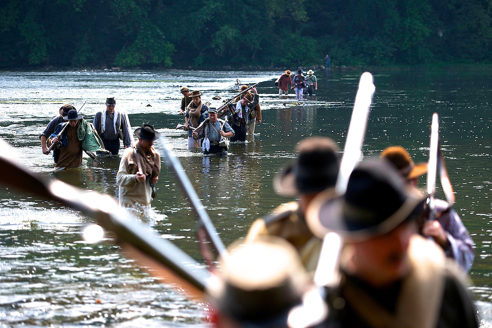 14th Tennessee infantry Confederate soldiers ford the Potomac River during General A.P. Hill's 18 mile march from Harper's Ferry, WV to Sharpsburg, MD during the 150th Antietam Civil War Reenactment.